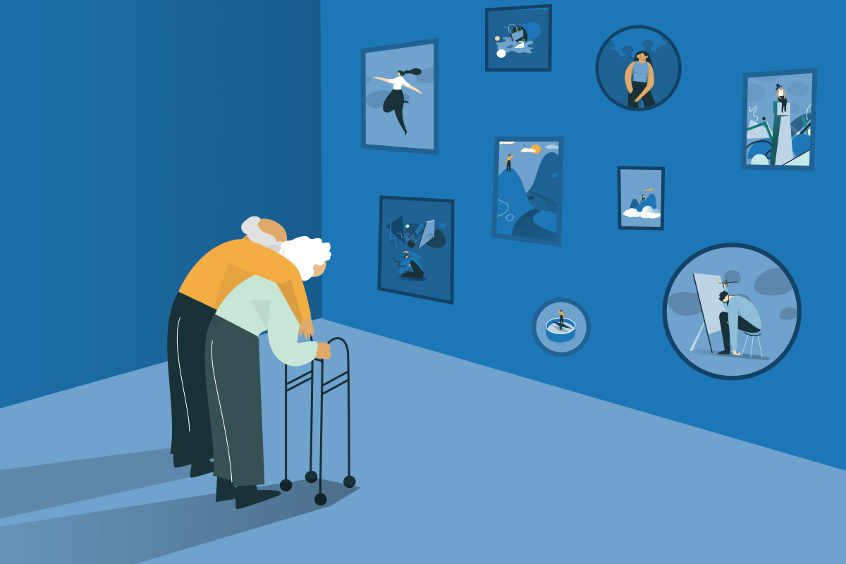 An elderly couple is looking at a wall with old pictures. Read our tips on how to deal with elderly depression.