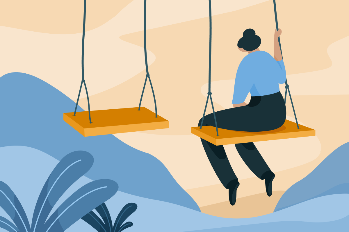 Loneliness - A person is sitting on a swing, facing another swing that is empty.